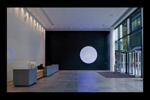 The buildings feature generous but minimally styled reception areas